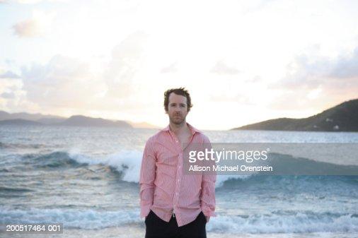 Man at beach, portrait