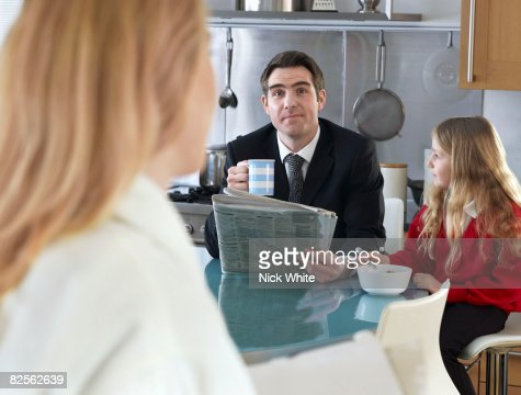 Man at breakfast table with daughter : Stock Photo