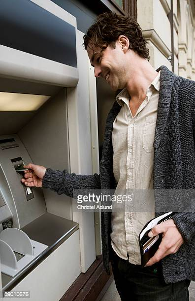 Man at cash dispenser