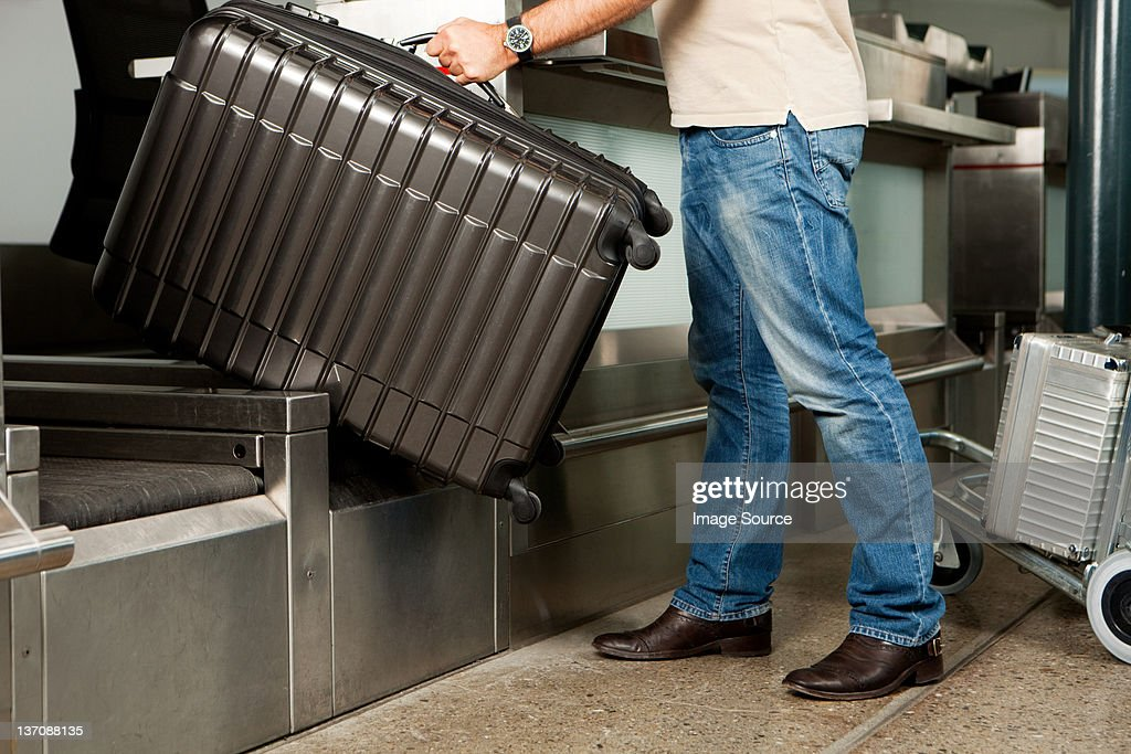 Man at check in desk of airport