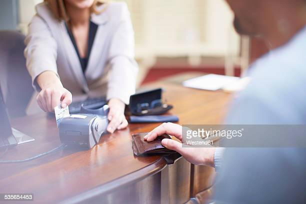 Man at counter paying with credit card