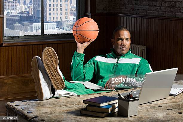 Man at desk with basketball