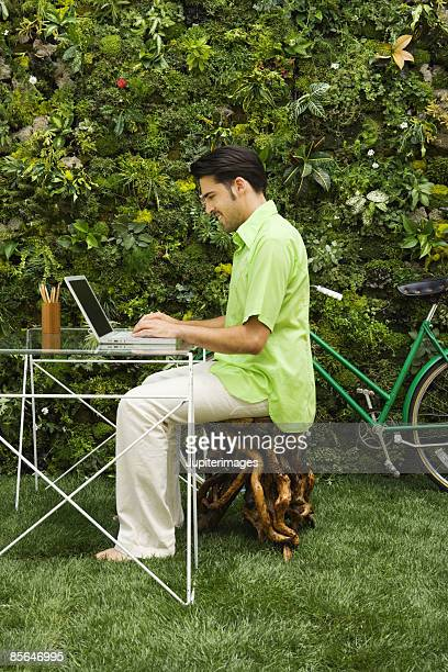 Man at desk with laptop computer