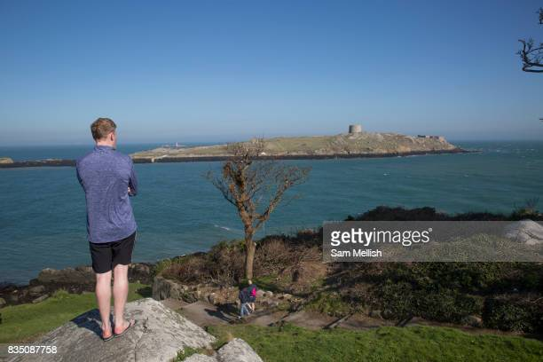 A man at Dillons Park overlooks Dalkey Island on 08th April 2017 in County Dublin Republic of Ireland Dalkey is one of the most affluent suburbs of...