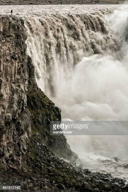 Man at gigantic Icelandic waterfall