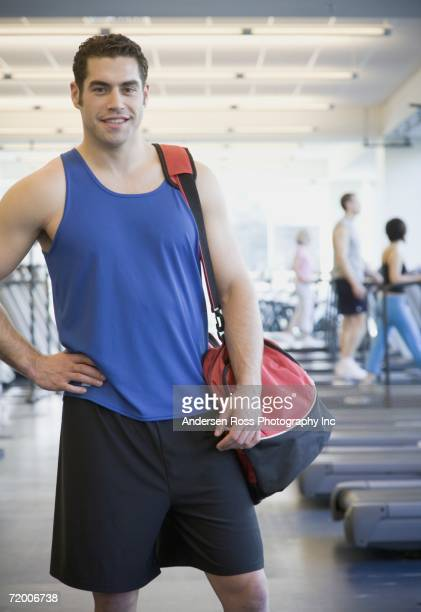 Man at gym with duffle bag