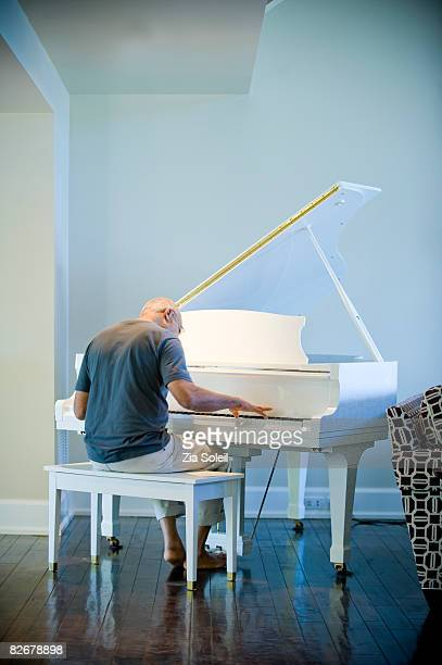 Man at his home piano