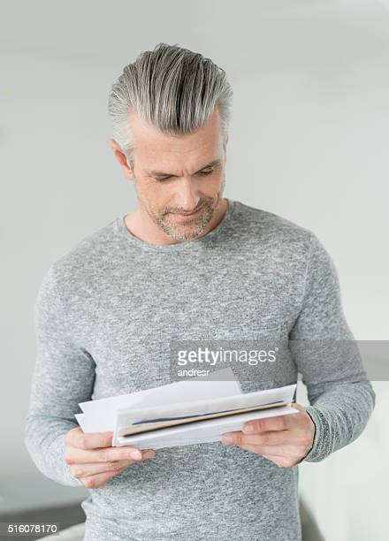Man at home getting the mail