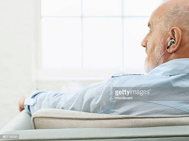 Man at Home Listening to Music