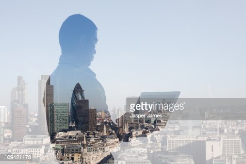 Man at laptop with cityscape : Stock Photo