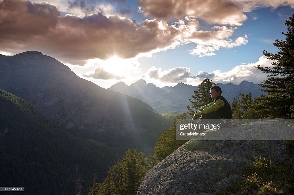 Man at mountain sunrise : Stock Photo