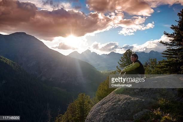 Man at mountain sunrise