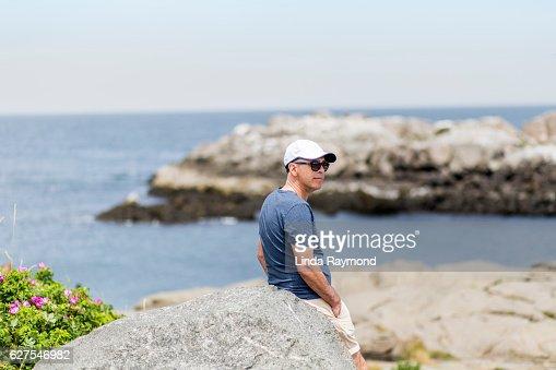 Man at Nubble lighthouse, York, Maine
