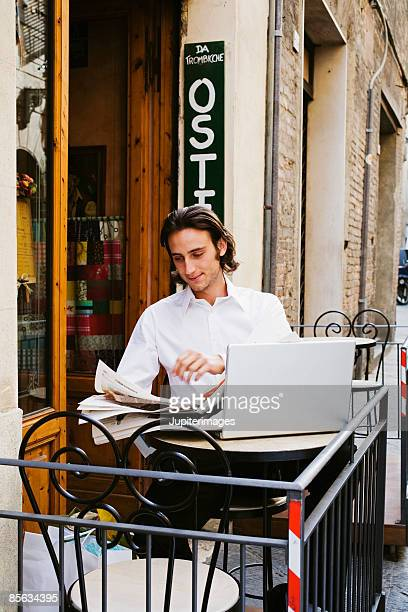 Man at osteria with laptop computer , Siena , Italy