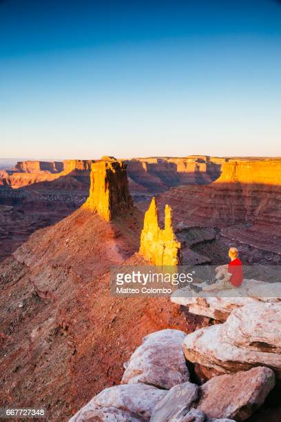 Man at overlook on canyon in the southwest, Utah, USA