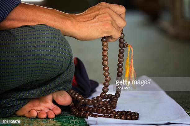 Man at prayer in Sule Paya