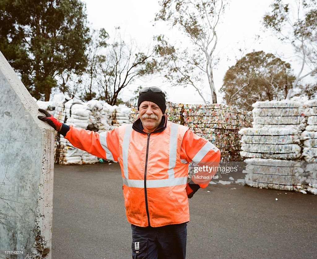Man at recycling centre : Stock Photo