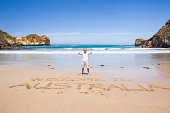Man at the beach, Welcome to Australia in sand