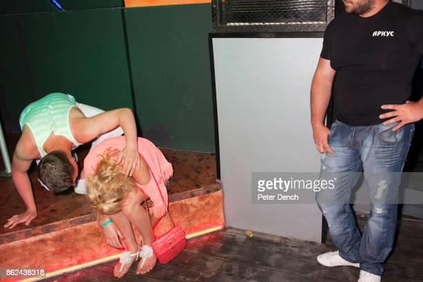 A man at the Disco Orange night club opening season party checks on the well being of 21 year old Lauren from Grantham