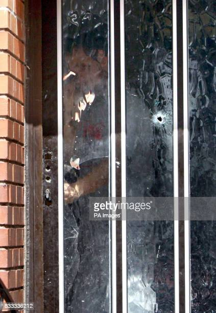 A man at the door of a house which was the scene of overnight shooting in Sean McDermott Street in Dublin's north inner city