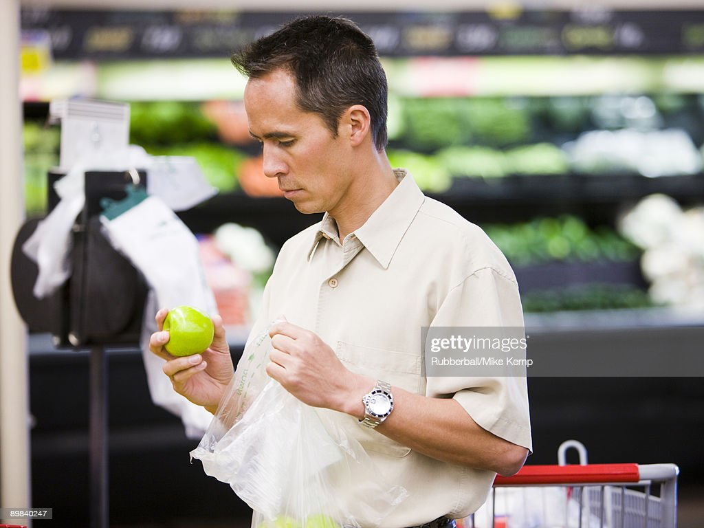 man at the grocery store : Stock Photo