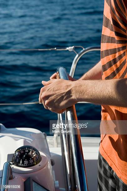 Man at the helm of a yacht
