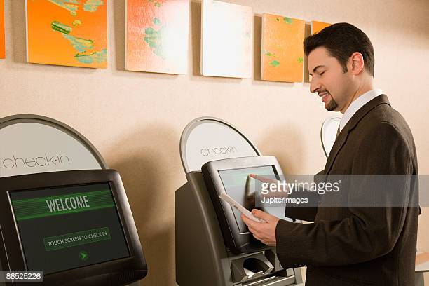 Man at touch screen kiosk