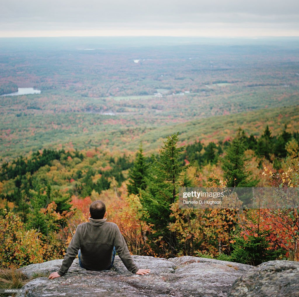 Man At Viewpoint Overlooking Autumnal Forest