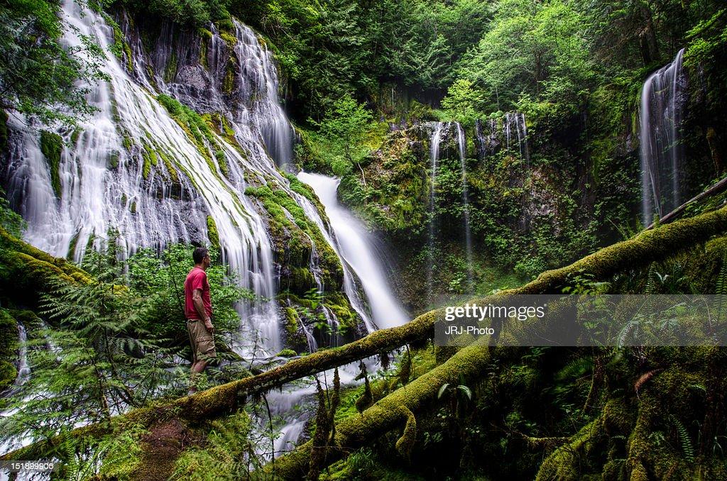 Man at waterfall