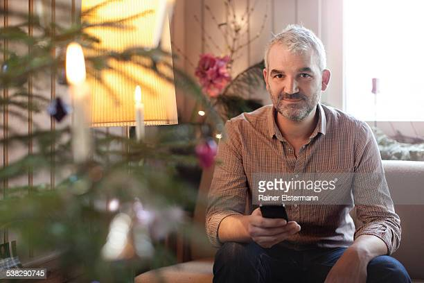 Man at X-Mas looking straight into camera