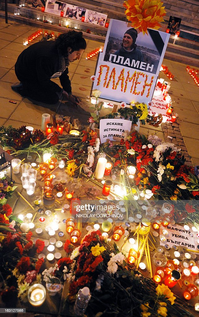 A man attends a candlelight vigil on March 4, 2013 outside the city hall of Varna, on the site where a man who became a symbol of the three-week wave of protests against corruption, set himself on fire. Plamen Goranov, a 36-year-old amateur photographer and rock climber, died the day before after setting himself ablaze on February 20 in the Black Sea city of Varna. Goranov's self-immolation prompted Varna protestors to adopt his cause and turn their initial anger over high electricity bills against the long-time mayor, whom they accused of corruption and favouritism towards a local business group.