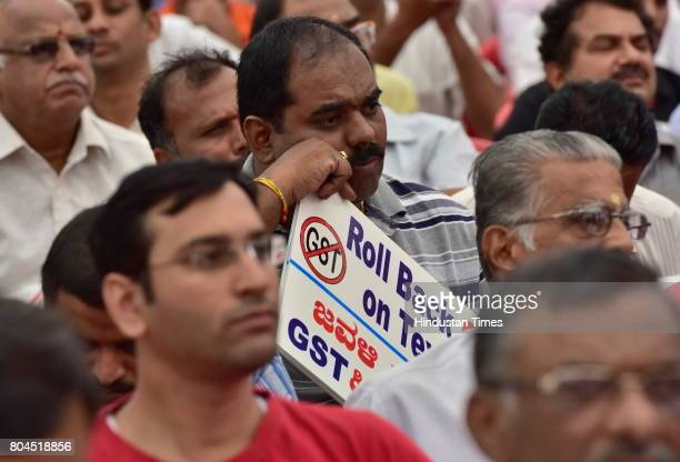 A man attends a meeting as All Karnataka Textile Association staging protest against the GST at Bannapa Park on June 30 2017 in Bengaluru India With...