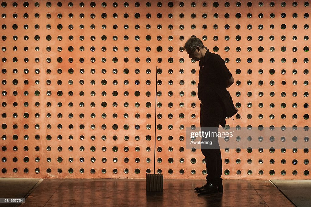 A man attends at the Reporting from the Front Pavillion of the 15th Architecture Venice Biennale, on May 27, 2016 in Venice, Italy. The 15th International Architecture Exhibition of La Biennale di Venezia will be open to the public from May 28 to November 27 in Venice, Italy.