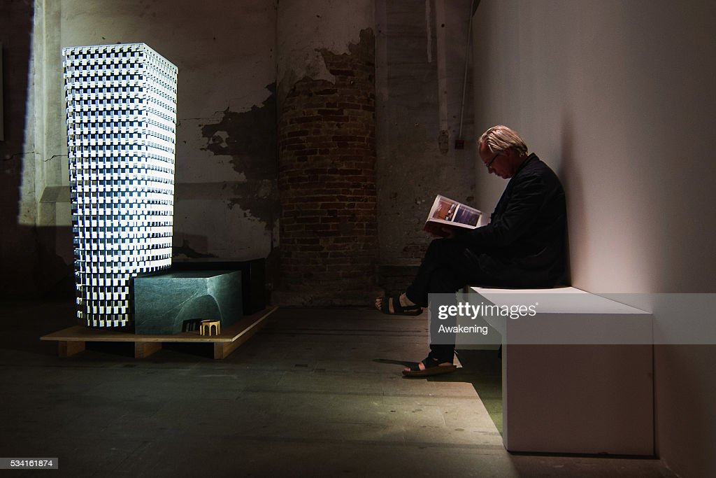 A man attends at the Reporting from the Front pavillon of the 15th Architecture Venice Biennale, on May 25, 2016 in Venice, Italy. The 15th International Architecture Exhibition of La Biennale di Venezia will be open to the public from May 28, 2016 in Venice, Italy.