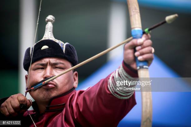 A man attends the traditional Nadaam festival in Ulan Bator on July 12 2017 The festivities consist of a number of national ceremonies concerts and...