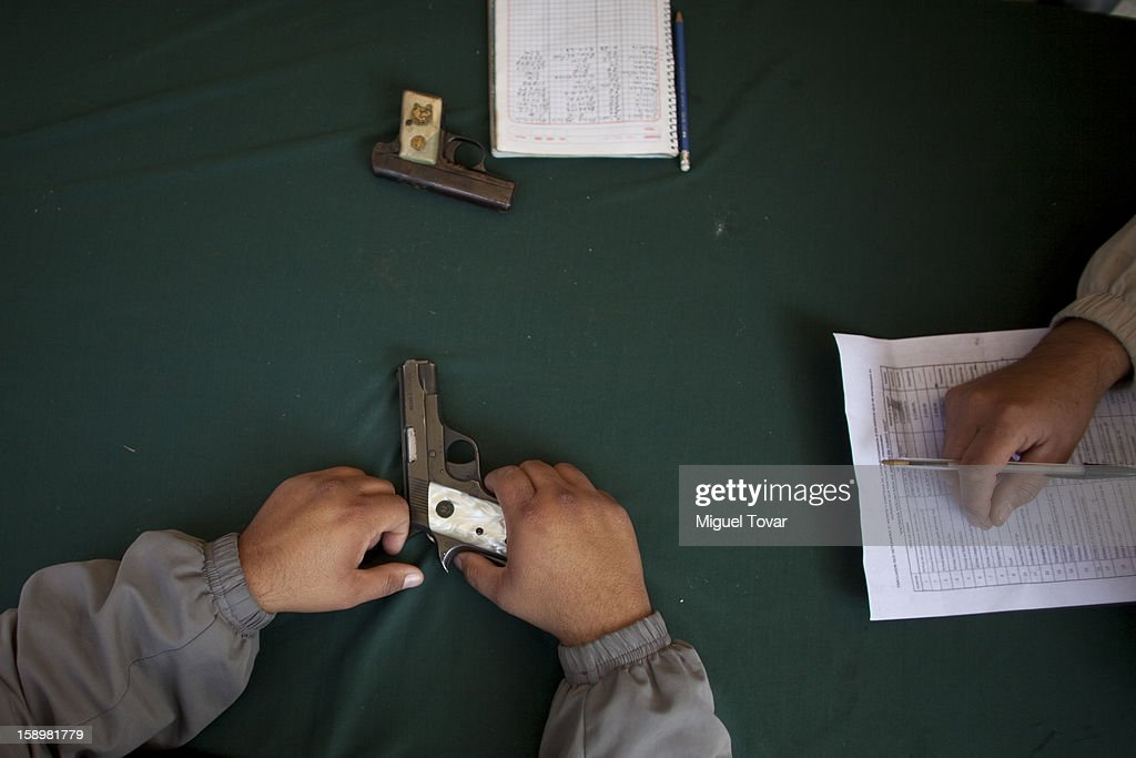 A man attends to exchange weapons in Mexico City on January 04, 2013 in Mexico City, Mexico. More than a thousand weapons have been changed for a tablet, bicycles or money in a low-income neighborhood in the capital, according to authorities.