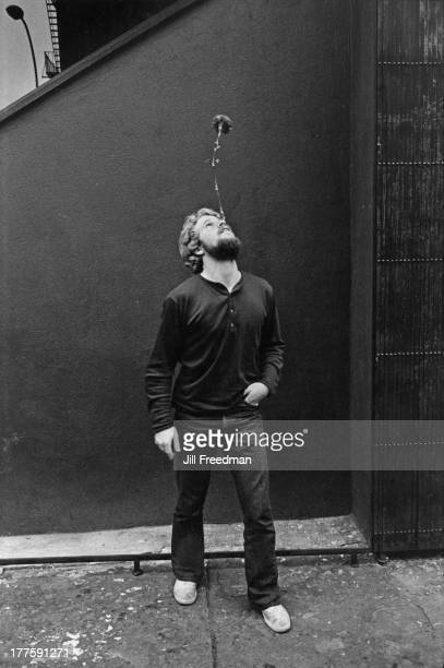 A man balances a flower on his nose New York City circa 1978
