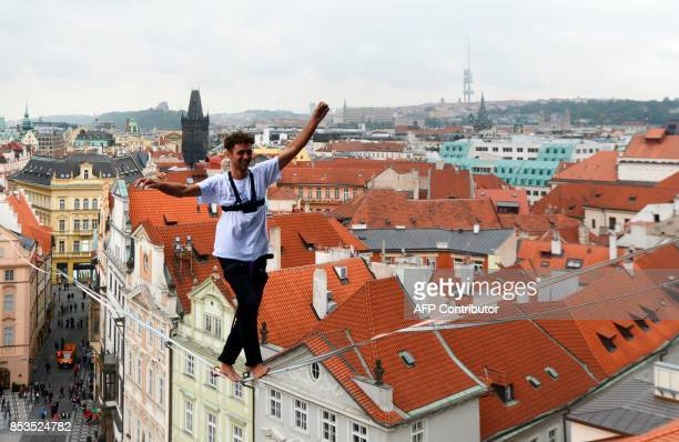 A man balances on a rope highly over the Old Town square as part of the 'Zivot na hrane' campaign supporting people diagnosed with diabetes on...