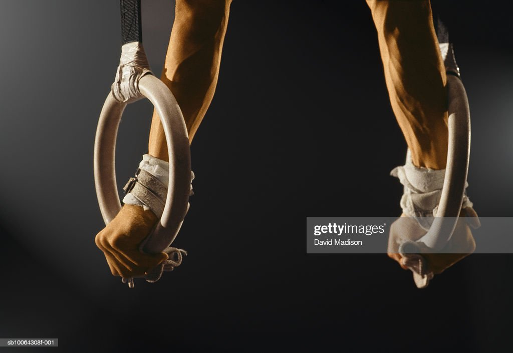 Man balancing on gymnastics rings : Stock Photo