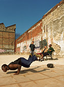 Man balancing on hands, break dancing