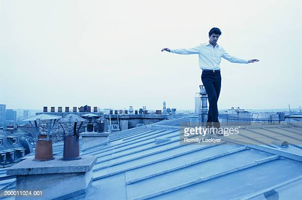 Man balancing on roof