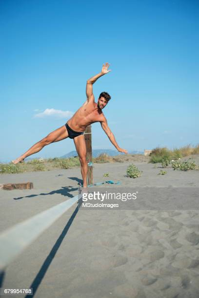 Man balancing on slack line