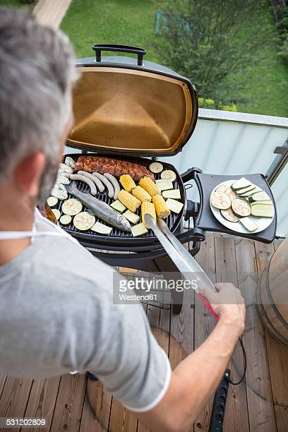 Man barbecuing on his balcony