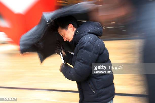 A man battles wind rain and sleet in the early hours of a major winter storm on February 8 2013 in New York City New York City and much of the...