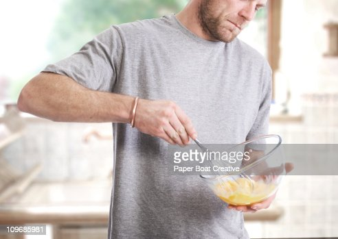 Man beating eggs with a whisk