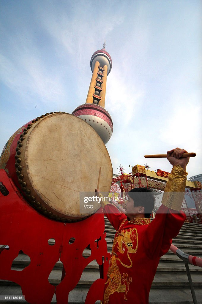 A man beats a drum to celebrate Chinese Lunar New Year of Snake in front of the Oriental Pearl TV Tower on February 10, 2013 in Shanghai, China. The Chinese Lunar New Year of Snake also known as the Spring Festival, which is based on the Lunisolar Chinese calendar, is celebrated from the first day of the first month of the lunar year and ends with Lantern Festival on the Fifteenth day.