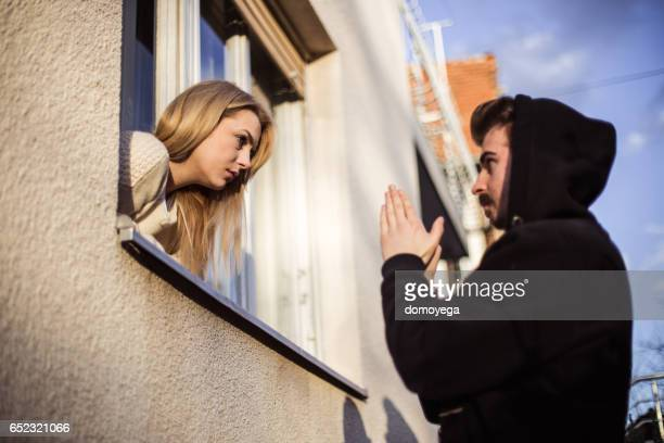 Man begging  his girlfriend to forgive him