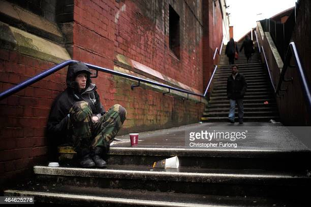 A man begs for loose change on the streets of Manchester on February 25 2015 in Manchester United Kingdom As the United Kingdom prepares to vote in...