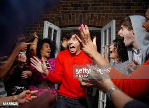 Man being surprised by his friends : Stock Photo