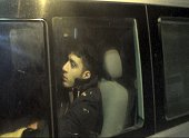 A man beleived to be a British citizen looks on as he is driven away from a Turkish military station on March 2 in Hatay 'Nine people of British...